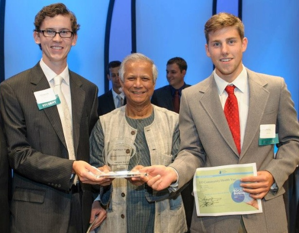 Orion (R) and Oliver (L) receive their award from Muhammad Yunus.