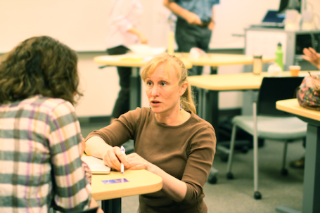 Deidre Schuetz works with a fellow student on mapping personal business plans, a final portion of the certificate curriculum.